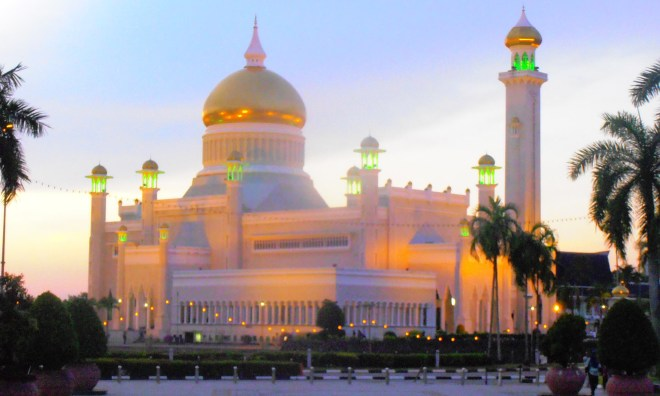 The Omar Ali Saifuddien Mosque glows at dawn and dusk
