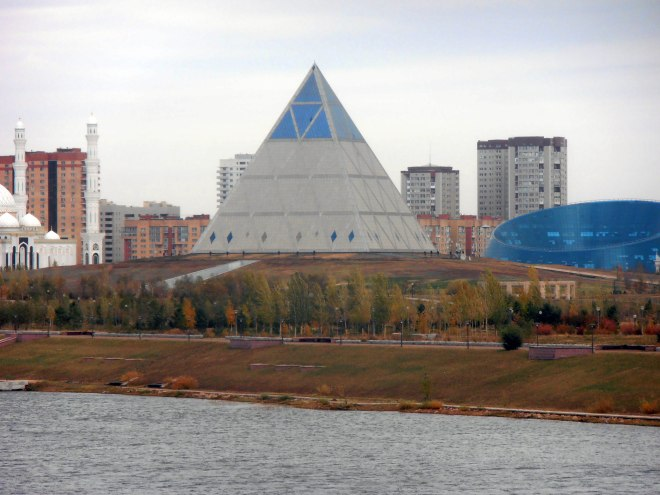 The Palace of Peace and Reconciliation beckons across the river in Astana